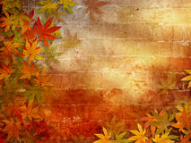 Autumn background with fall leaves. Fall leaves frame against brick wall with sunlight effects Royalty Free Stock Photography