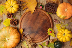 Autumn background with fall leaves and pumpkin over wooden table. View from above Stock Image
