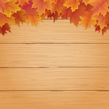 Autumn background with fall leaves on wood Royalty Free Stock Photo