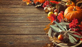 Autumn background from fallen leaves and fruits with vintage pla Stock Images