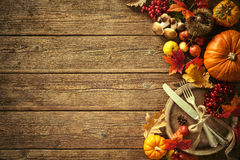Autumn background from fallen leaves and fruits with vintage pla Royalty Free Stock Photo
