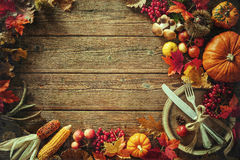 Autumn background from fallen leaves and fruits with vintage pla Royalty Free Stock Photos