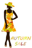 Autumn background with fashion woman with dress made of leaves Royalty Free Stock Images