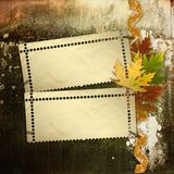 Autumn background with foliage and grunge papers Stock Images