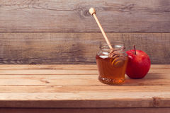 Autumn background with honey and apple Stock Images