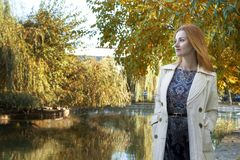 Autumn background, the lake, the girl looks into the distance stock images