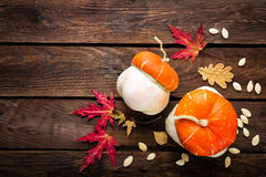 Autumn background with leaves and pumpkins, thanksgiving and halloween card Royalty Free Stock Photography
