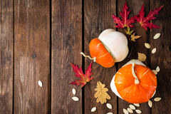 Autumn background with leaves and pumpkins, thanksgiving and halloween card Royalty Free Stock Photo