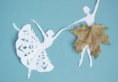 Autumn background with leaves and showflakes, ballet dancer royalty free stock photo