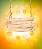 Autumn background with leaves. And wooden sign. Vector Stock Photography
