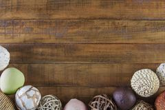 Autumn background with natural fiber ornaments framing rustic wood table stock images
