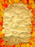 Autumn background on old paper. Autumn background with colored leaves on old paper. EPS 8  file included Royalty Free Stock Photo