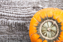 Autumn background with pumpkin on wooden board Royalty Free Stock Photo