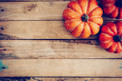 Autumn background with pumpkin on wooden board with space, Vinta Royalty Free Stock Photography