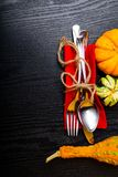 Autumn background, pumpkin with silver place setting on dark wooden table. Thanksgiving day concept royalty free stock photography