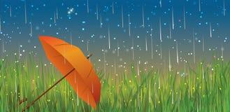 Autumn background with rain and orange umbrella Stock Images