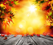 Autumn background with red falling leaves on wood. En plank stock photos