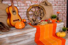 Autumn background with Rye, wheat, with yellow maple leaves, pumpkins, red apples. Frame of fall harvest on aged wood stock photography