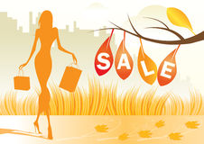 Autumn background with shopping woman Stock Photography