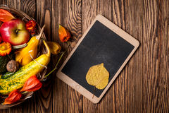 Autumn background and tablet on wooden boards. Space for your text. Top of view. Stock Photo