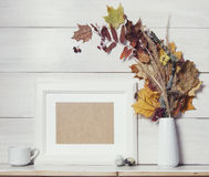 Autumn background template with white wooden frame and dry leave Stock Image