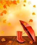 Autumn background with umbrella and rain boots. Royalty Free Stock Photography
