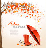 Autumn background with umbrella and rain boots. Royalty Free Stock Images