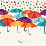 Autumn background with umbrellas in flat design Stock Photos