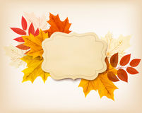 Autumn background with a vintage card and colorful leaves. Royalty Free Stock Photos