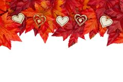 Autumn background with wood hearts and red and orange fall leave stock photo