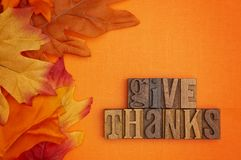 Autumn Background with the Words Saying Give Thanks in Block Let. An Autumn Background with the Words Saying Give Thanks in Block Letters stock images
