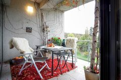Autumn balcony. Garden view from a balcony decorated with fruits and leaves stock photography