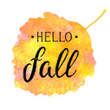Autumn banner with textured brush lettering on abstract watercolor leaf shaped background. Hello fall. Hand drawn Stock Photography