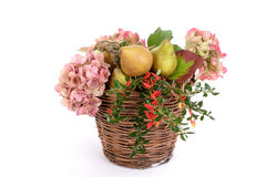 Autumn basket. Reed basket with flowers and pears stock photos