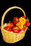 Autumn basket with apples and flowers Stock Image