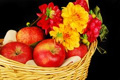 Autumn basket with apples and flowers Stock Photo