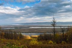 Autumn is a beautiful view of the river Amur Khabarovsk region of the Russian Far East. Meandering rivers by name Amur Khabarovsk. Region of the Russian Far stock images