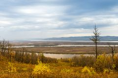 Autumn is a beautiful view of the river Amur Khabarovsk region of the Russian Far East. Meandering rivers by name Amur Khabarovsk. Region of the Russian Far royalty free stock photos