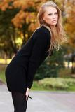 Autumn beauty. Blonde young woman in Autumn outdoor Stock Image