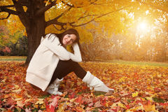 Autumn beauty. Portrait of beautiful young woman in autumn park. Copyspace stock photography