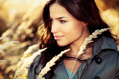 Autumn beauty. Young woman in topcoat portrait at autumn meadow Stock Image