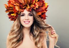 Autumn Beauty. Beautiful Woman Spa Model. With Perfect Curly Blonde Hairstyle, Makeup and Fall Leaves Wreath Smiling Stock Image