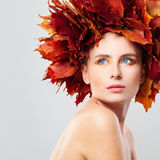 Autumn Beauty. Woman in Wreath of Fall Leaves Royalty Free Stock Images