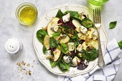 Autumn beet root salad with blue cheese,apple,,spinach and walnu Royalty Free Stock Photo