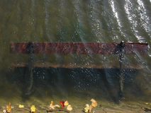 Autumn bench in the water. Autumn bench drowned in the water Stock Photos