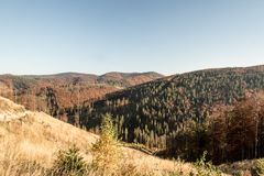 Free Autumn Beskid Zywiecki Mountains On Polish - Slovakian Borderland With Hills Covered By Colorful Forest And Clear Sky Stock Photo - 138233090