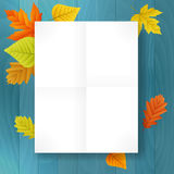 Autumn blank paper on blue wood background Royalty Free Stock Image