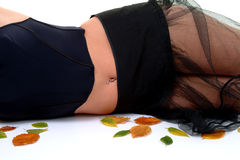 Autumn Blues (Colour). Torso of female lying on floor wearing blue bodice and black net skirt Royalty Free Stock Photography