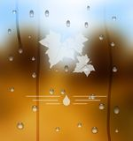 Autumn blurred background as a glass with raindrops. Stock Photos