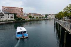 A boat on the Rhone river in Geneva stock image